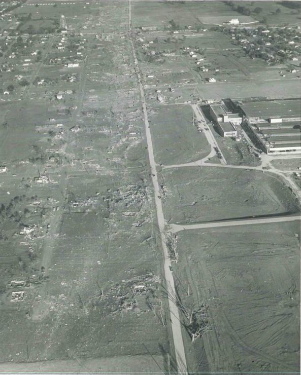An aerial view of Coldwater Road, looking west, shows the extraordinary intensity of the narrow damage path. The North Flint Drive-In can be seen in the upper right corner.